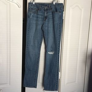 Medium-wash straight leg Gap Jeans with a knee rip